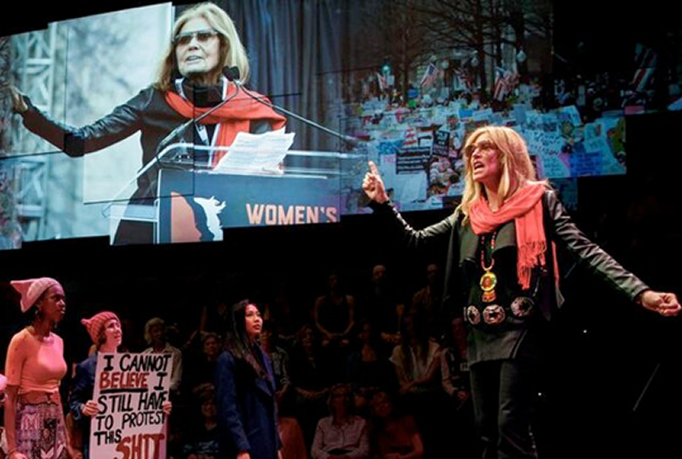 Christine Lahti in front of Gloria Steinem photo. Photo by Joan Marcus.